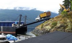 Ramp barge loading House demo material from job site up Indian Arm.